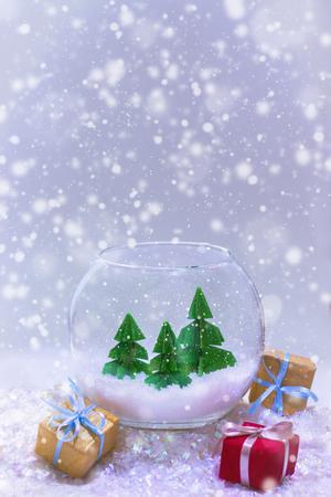 miniature with three paper pine trees in the aquarium