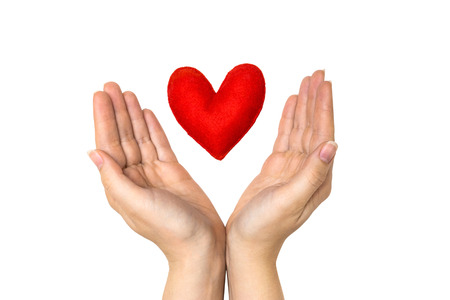woman hands holding heart figure made from red fabric isolated on white
