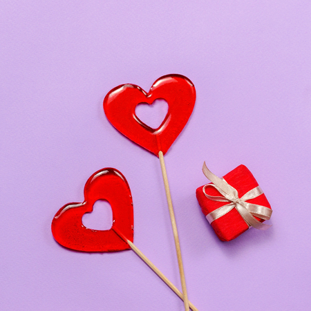 red hart shaped lollipops and small present boxes, valentines day concept