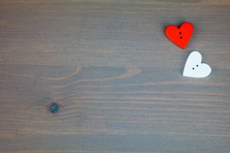 wooden post: Red hearts on grey wooden background. Button love. Wooden buttons. Post card for the Valentine.