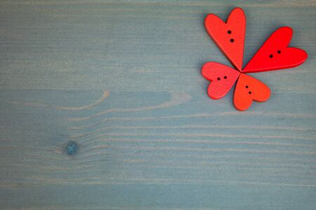 wooden post: Wooden butterfly from hearts on grey wooden background. Button love. Wooden buttons. Post card for the Valentine.