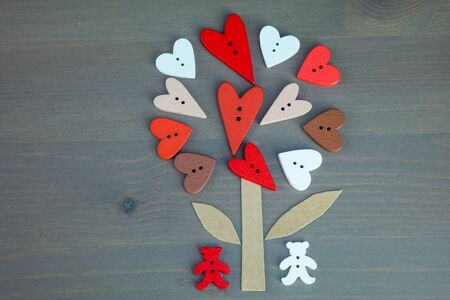 love tree: Post card for the Valentine. Button love. Wooden buttons. Button love tree and two bears on grey wooden background. Valentines Day postcard. Two bears with hearts. Button bears love.