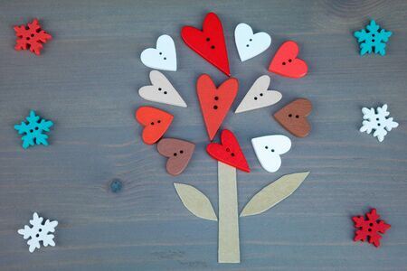 love tree: Post card for the Valentine. Button love. Wooden buttons. Button love tree and snowflackes on grey wooden background. Valentines Day postcard.