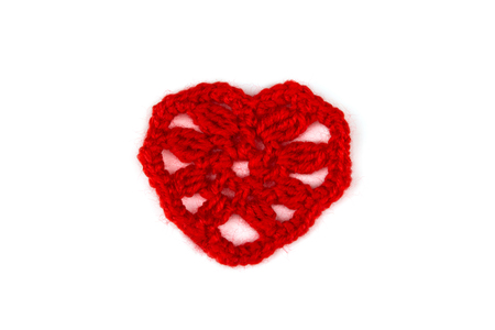 knitted: Knitted red heart. Isolation. Stock Photo