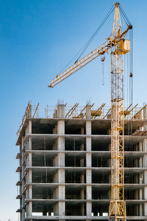 steel construction: Building under construction and crane.