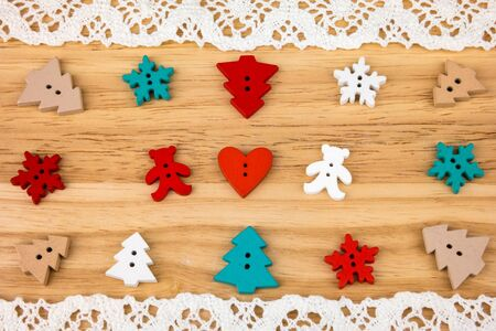 day saint valentin: Two bears with hearts, snowflakes and trees on wooden background with lace. Button bears love. Button love. Wooden buttons. Post card for the Valentine.