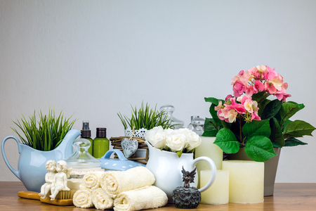 bath salts: Composition of cosmetic bottles, soap, towel, bath salts and brush.