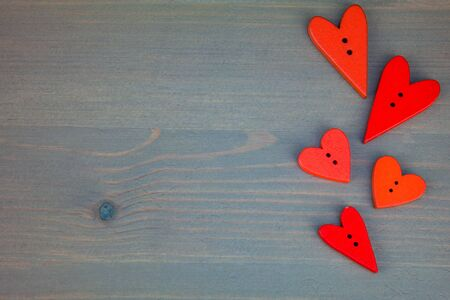 Red hearts on grey wooden background. Stock Photo