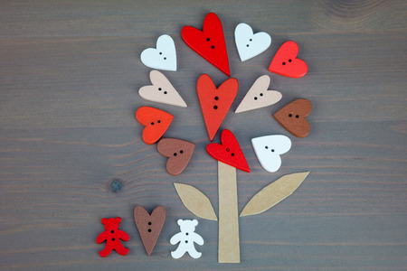 love tree: Button love tree and two bears on grey wooden background.