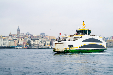 kadikoy: Istanbul ferry on Bosphorus, Turkey. Passenger Ferry on Bosporus. Ship on Bosporus with Galata Tower on background. View from Istanbul with Galata Tower and the ferry.