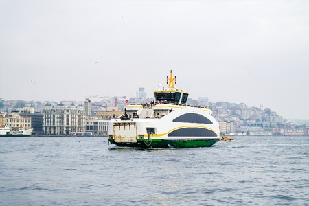 kadikoy: Istanbul ferry on Bosphorus, Turkey. Passenger Ferry on Bosporus. Ship on Bosporus with Galata Tower on background. View from Istanbul. Stock Photo