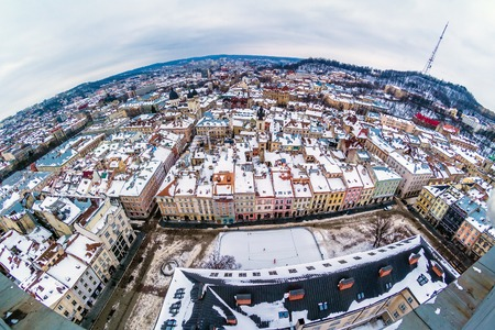 the old town hall: Winter panorama view from the Town Hall on the downtown in Lviv, Ukraine. Old buildings. Roofs covered by snow. Stock Photo