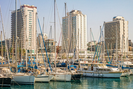 Yachts and boats in Tel-Aviv marina with cityscape in background, Israel. Foto de archivo