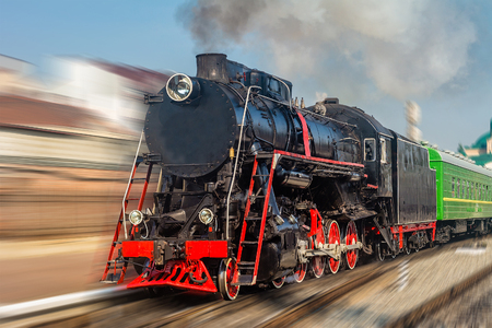 Old black and red steam locomotive with motion blur. Stock Photo