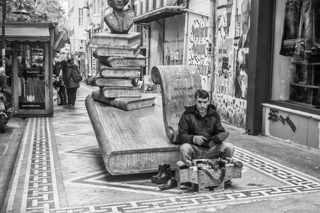 ISTANBUL, TURKEY - November, 2015: Street Life in the Asian part of Istanbul in the Kadikoy district. Shoeblack. Editorial
