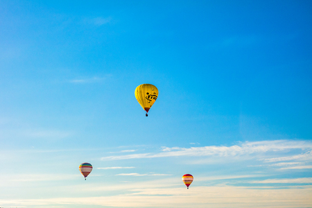 Kamyanets-Podilskyi, Ukraine - May 2017: Colorful hot air balloons in flight over blue sky.