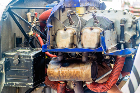 Uncovered engine of small light plane. Detail.