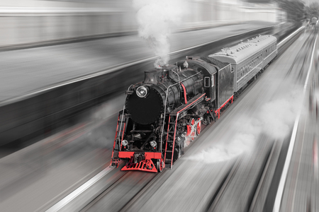 Old black and red steam locomotive with motion blur. 免版税图像