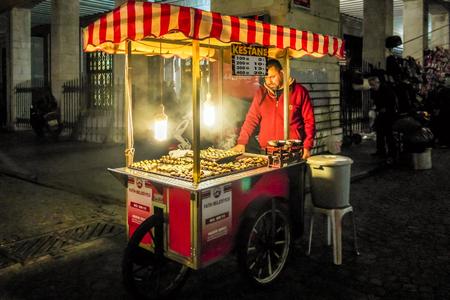 ISTANBUL, TURKEY - November,2015 Street photo. Chestnuts (Kestane) seller in Sultanahmet Square at night. Editorial
