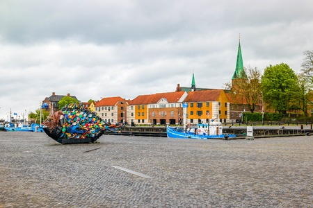 Helsingor, Denmark - May, 2019: Garbage fish on the marina near Kronborg Castle made by Japanese artist Hideaki Shibata, who is also known as Yodogawa Technique.