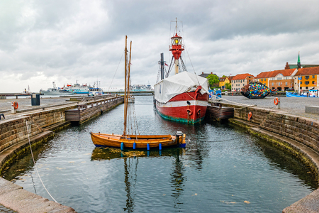 Helsingor, Denmark - May, 2019: Street view with colorful buildings and ships in Helsingor, Denmark. Редакционное