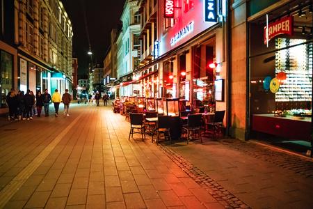 Copenhagen, Denmark - May, 2019: Street life in Copenhagen at night.