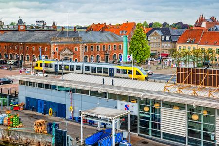 Helsingor, Denmark - May, 2019: Tram driving through central Helsingor near train station. Редакционное