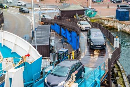 Helsingor, Denmark - May, 2019: Cars ride on ferry in Helsingor port near train station.