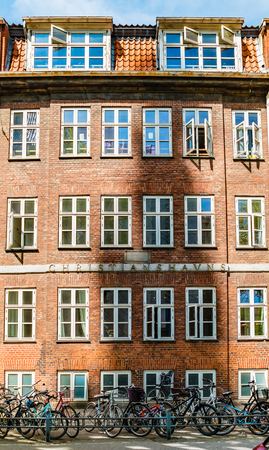 Copenhagen, Denmark - May, 2019: Exterior architecture. Facade of old building in Copenhagen. Редакционное