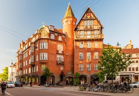Copenhagen, Denmark - May, 2019: Street life in Copenhagen. People riding bikes in the city center.