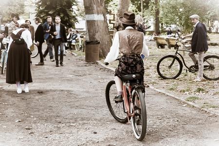 Ivano-Frankivsk, Ukraine - September 28, 2019: Retro cruise de Frankivsk. People in retro clothes participating in bicycle tweed run Retro cruise. Редакционное