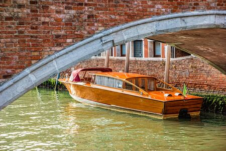 Water taxi on canal street in Venice, Italy. Standard-Bild