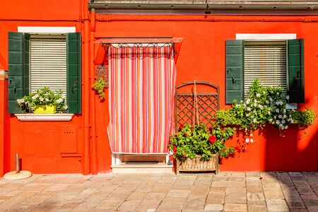 Orange house on Burano island near Venice, Italy.