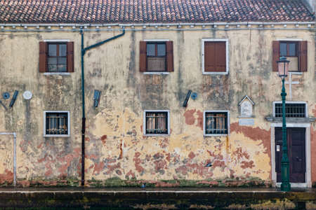 Facade of building next to the waterfront of the lagoon on Giudecca island.