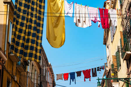 Laundry hanging out of a typical Venetian facade. Italy.