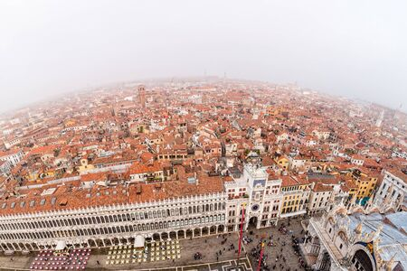 Foggy view from the top of Campanile di San Marco in the morning. Venice, Italy.