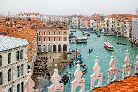 Top view of Grand canal from roof of Fondaco dei Tedeschi. Gondolas and boats traffic.