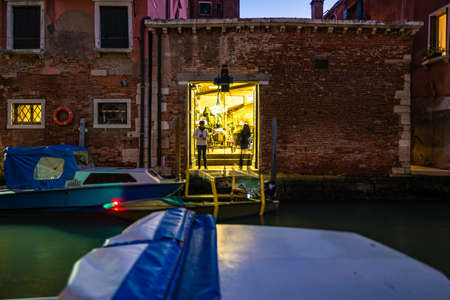 Venice, Italy - October, 2019: Venice view at night with canal, bridge and historical buildings. Editorial