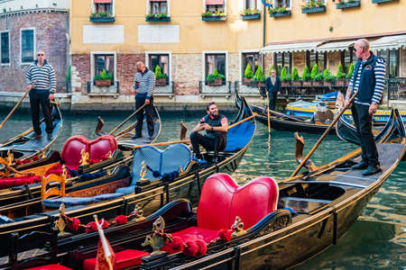 Venice, Italy - October, 2019: Group of gondolas moored in front of the popular Cavalletto Hotel, Orseolo basin in downtown of Venice.
