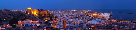 stronghold: Panoramic view to the night overlooking the Citadel of Almería, the harbor and the sea  Andalucia tourism in Spain