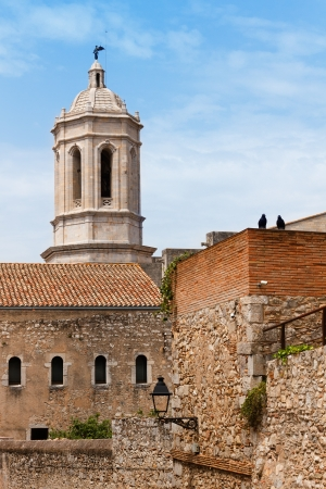 Tower of the gothic cathedral of Girona, seen from the old neighborhood, tourism in Catalonia, Spain