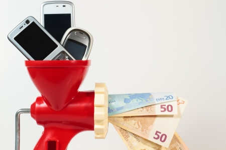 Sell your old mobile phones to win money and help the environment by recycling, ecological attitude. Stock Photo - 14398695