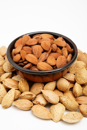 Almonds in a bowl, snacks of nuts, almonds in shell Stock Photo
