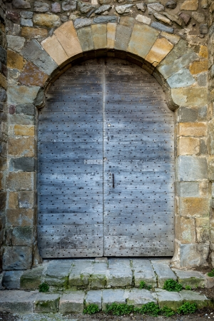 Old gate in the medieval walls of the Cite de Carcassonne Stock Photo