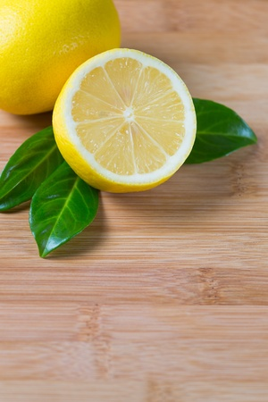 fresh lemons on a bamboo table, fruit rich in vitamin c