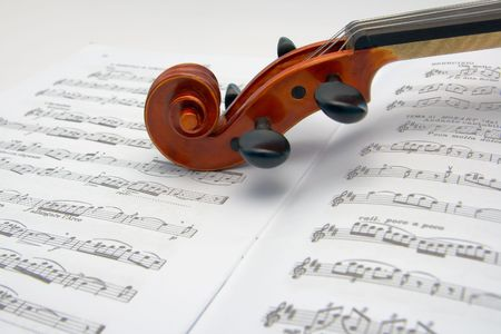 violins: Violin scroll resting on a sheet music