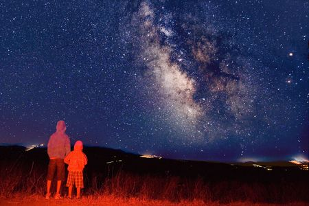 observers: Young observers looking at the milky way Stock Photo