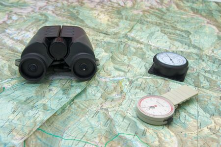 altimeter: Planning a trip to the mountain with binoculars, altimeter, pedometer and map Stock Photo