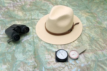 altimeter: Planning a trip to the mountain with map, pedometer, altimeter, binoculars and hat