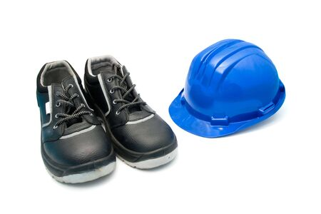 safety shoes: Isolated safety shoes and blue helmet for workers Stock Photo